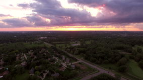 Troy Michigan Aerial. V3 Flying low backwards over neighborhood with sunset views stock footage