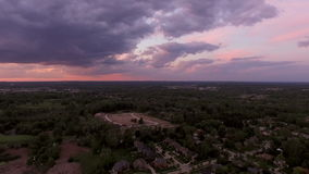 Troy Michigan Aerial. V4 Flying low over neighborhood panning right with sunset views stock video footage