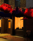 Troy NY USA - Cafe street scene with colorful lit skirts in the evening. Stock Photos
