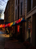 Troy NY USA - Cafe street scene with colorful lit skirts in the evening. Stock Image
