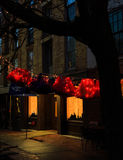 Troy NY USA - Cafe street scene with colorful lit skirts in the evening. Royalty Free Stock Photography