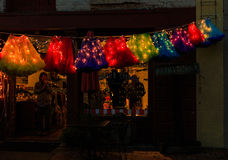 Troy NY USA - Cafe street scene with colorful lit skirts in the evening. Royalty Free Stock Image