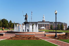 Troy University. Scenic view of Troy university campus with water fountain and Trojan soldier statue in foreground, Alabama, U.S.A Royalty Free Stock Photo