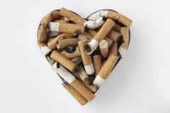 Trozos del cigarrillo Fotos de archivo
