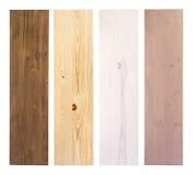 Träplankor i olika färger som isoleras på vit Arkivbild