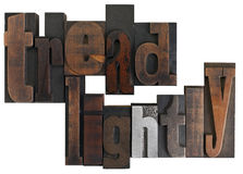 Tread lightly, written in vintage printing blocks. Phrase tread lightly in vintage wooden letterpress type, scratched and stained, isolated on white background Stock Photos