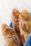 Três Baguettes franceses duros Imagens de Stock