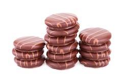 Três bolinhos do chocolate Fotos de Stock