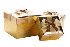 Três caixas douradas Imagem de Stock