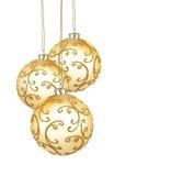 Três esferas douradas bonitas do Natal Imagens de Stock Royalty Free