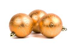 Três esferas douradas do Natal Imagem de Stock Royalty Free
