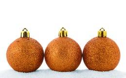 Três esferas douradas do Natal Foto de Stock