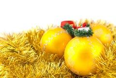 Três esferas douradas do Natal Imagens de Stock