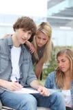 Três estudantes Foto de Stock Royalty Free