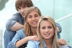 Três estudantes Fotos de Stock Royalty Free