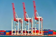 Três guindastes do porto Imagens de Stock Royalty Free
