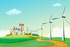 Três moinhos de vento na cume através das construções altas Imagens de Stock Royalty Free