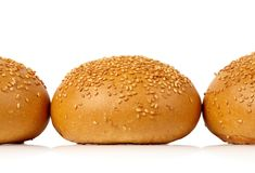 Três rolos com semente de sésamo Foto de Stock