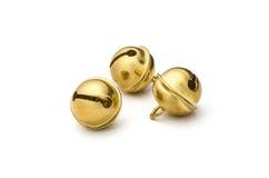Três sinos de trenó dourados Fotos de Stock Royalty Free