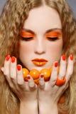 Trucco arancione immagini stock