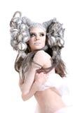 Trucco creativo e capelli su una ragazza di modo Fotografia Stock
