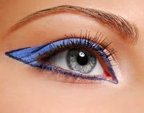 Trucco di modo - freccia blu Fotografia Stock