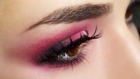 Trucco rosso dell'occhio. Fotografia Stock Libera da Diritti