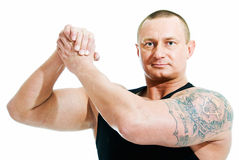 Truce. Athletic man shows sign of truce on white background Royalty Free Stock Photography