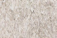 Truciolato dipinto bianco Struttura della superficie ruvida Immagini Stock