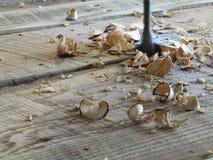 Trucioli di legno del pezzo noioso Immagine Stock