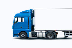 Truck. Blue semi truck pulling trailer on white background Stock Images