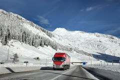 Truck. Running on snowy highway Stock Image