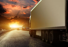 Truck. White truck on asphalt road under blue sky with clouds Stock Photos