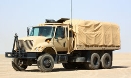 A truck. A military transportation truck isolated on a clear sky background Stock Images