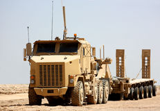 A truck. A heavy armored military truck with trailer outdoor isolated on a clear sky background Royalty Free Stock Photos