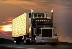 Truck. Big truck driving on a highway with sunset in background stock photography