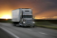 Truck. At sunset with motion blur Stock Photography
