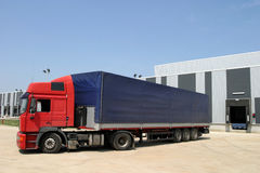Truck. A truck ready to load cargo from a warehouse Royalty Free Stock Image