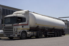 Truck. White truck tank in a street, tank is white stock photo