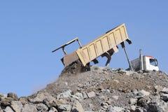 Truck. Construction dump truck dumping load Stock Photography