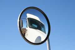 Truck. Panned out view of a convex mirror showing a truck stock image