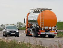 Truck. Oil transporter truck driving on the road Stock Images