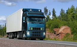 Truck. On highway with rocks and trees Royalty Free Stock Photos