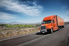 Truck. Orange American truck on freeway road Royalty Free Stock Images