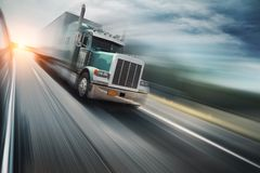 Truck. American truck speeding freeway, blurred motion stock image