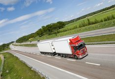 Truck from above. Large red/white lorry driving on highway (side-view) and countryside Royalty Free Stock Photos