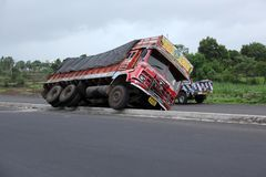 Truck Accident in India. A truck toppled over on a highway in India due to speeding Royalty Free Stock Image
