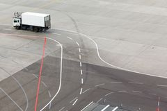 Truck, airfield and markings on apron Royalty Free Stock Image