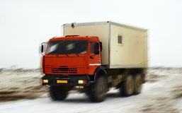Truck all-terrain. Moves across the steppe in winter Royalty Free Stock Photos