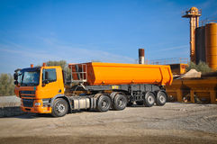 Truck on the asphalt plant. Machinery equipment at the work stock photos